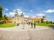 KRAKOW, POLAND - JUNE 08, 2016: Tourists on their way towards historical complex of Wawel Royal Castle and Cathedral in Krakow, Po Stock Photo
