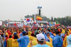 KRAKOW, POLAND -  2016:  Krakow Blonia, World Youth Day 2016, pi. Lgrimi in raincoats listen to the Pope, the rain Stock Photography