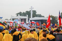 KRAKOW, POLAND - 2016: Krakow Blonia, World Youth Day 2016, pi. Lgrimi in raincoats listen to the Pope stock photo