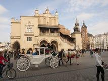 KRAKOW, POLAND - March 29, 2015: Horse carriage on the streets o Stock Photos