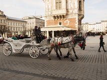 KRAKOW, POLAND - March 29, 2015: Horse carriage on the streets o Stock Image