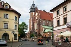 KRAKOW, POLAND - MAY 27, 2016: Gothic roman catholic Corpus Christi Basilica in the Kazimierz district of Krakow. Kazimierz is the one of the oldest districts stock image