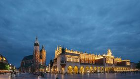 Krakow, Poland. Night View Of St. Mary`s Basilica And Cloth Hall Building. Famous Old Landmark Church Of Our Lady stock video footage