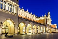 Krakow - Poland. Old Market with Cloth-Hall and Mariacki Church Stock Photos