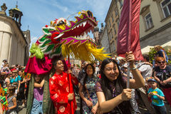 KRAKOW, POLAND -  During the parade of dragons on Main Square near St.Mary's Basilica. Stock Photos