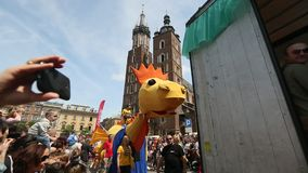 KRAKOW, POLAND -  During the parade of dragons on Main Square near St.Mary's Basilica. stock footage