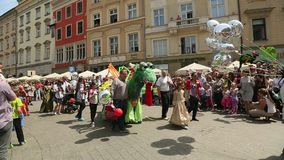 KRAKOW, POLAND -  During the parade of dragons on Main Square near St.Mary's Basilica. stock video footage