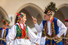 KRAKOW, POLAND - Polish folk collective on Main square during annual Polish national and public holiday the Constitution. Stock Photos