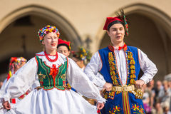 KRAKOW, POLAND -  Polish folk collective on Main square during annual Polish national and public holiday the Constitutution Day Stock Image
