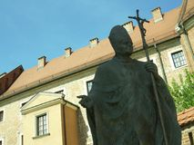 Pope sculpture and the buildings Royalty Free Stock Photo