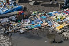 Krakow, Poland - September 21, 2019: Man sells a lot of books on the edge of a puddle of water at the Krakow street flea royalty free stock photography
