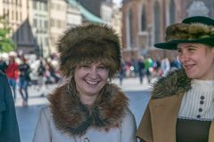 Krakow, Poland - September 23, 2018: nStylish Pretty young woman dressed in World War I period clothing smiling among royalty free stock photography