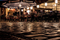 KRAKOW, POLAND - SEPTEMBER 18, 2015: People are resting in cafe. Outdoors in Kazimierz. Former jewish quarter of Krakow in night stock image