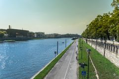 Krakow, Poland - September 21, 2019: People is walking and cycling on the cycle path at the banks of the vistula river stock images