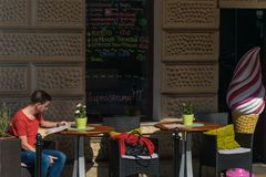 Krakow, Poland - September 21, 2019: Tourist reads the menu in a bar near Wawel castle. Tourist reads the menu in a bar near Wawel castle stock photos