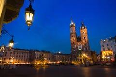 KRAKOW, POLAND - St. Mary's Church on Rynek Glowny (Market Square) in night time. Royalty Free Stock Photo
