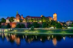 Krakow, Poland. Wawel castle and Vistula River at night. Poland, Krakow. Illuminated royal Wawel castle and cathedral at night and its reflection in Vistula Stock Photography