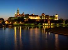 Krakow, Poland. Wawel cathedral, castle and Vistula at night. Poland, Krakow. Illuminated royal Wawel castle and cathedral at night and light reflections in Royalty Free Stock Photos