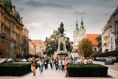Krakow, Poland. Woman Guide Conducts A Tour For Schoolchildren N. Krakow, Poland - August 28, 2018: Woman Guide Conducts A Tour For Schoolchildren Near The stock image