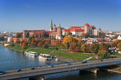 Krakow Skyline with Zamek Wawel Castle in Fall. Panorama of Cracow, Poland, with Zamek Wawel castle, Vistula river and Podwawelski bridge in autumn. Aerial view royalty free stock image