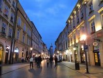 Krakow street in evening Stock Images