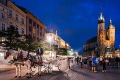 Krakow Targowy kwadrat przy nocą, Polska Fotografia Stock