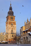 Krakow - Town Hall Tower - Poland. The Town Hall Clock Tower and the southern end of the Cloth Hall Building in the Market Square (Rynek Glowny) in the city of Stock Photography