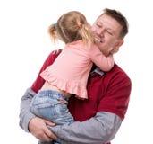 Kram av fadern och hans lilla dayghter i hans armar Arkivbild