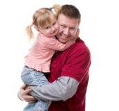Kram av fadern och hans lilla dayghter i hans armar Fotografering för Bildbyråer
