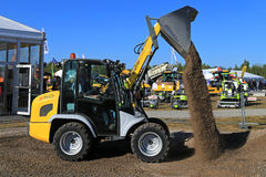 Kramer Allrad 350 Wheel Loader Unloads Gravel Stock Image