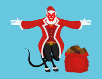 Krampus Satan Santa. Claus red demon with horns. Christmas monst. Er for bad children and bullies. folklore evil. Devil with beard and mustache. shit bag for Royalty Free Stock Images