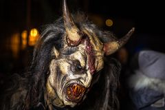 Closeup on grinning horned devil in traditional krampuslauf with wooden masks in Retz, Austria royalty free stock photos