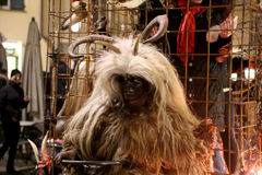 Krampus with white hair. Brixen/Bressanone, South Tyrol, Italy - December 05, 2013: A traditional parade of the Krampus, beast-like creatures march through the Royalty Free Stock Photos