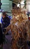 Krampuslauf in Salzburg. SALZBURG, AUSTRIA - DECEMBER 21: A wooden mask wearing person walks during the Christmas Devil Run in German: Krampuslauf at Domplatz on Stock Photography