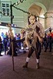 Krampuslauf in Salzburg. SALZBURG, AUSTRIA - DECEMBER 21: Wooden mask wearing persons walk during the Christmas Devil Run in German: Krampuslauf at Domplatz on Royalty Free Stock Photography