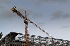 Kran an der Baustelle Stockbild