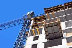 Kran und Baustelle Stockfotografie