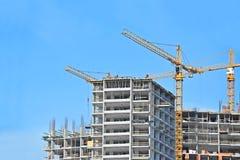 Kran und Baustelle Stockfotos