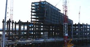 Kranar p? under-konstruktionen i Tokyo lager videofilmer