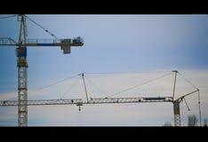Kranen op een bouw stock foto