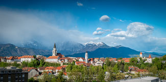 Kranj, Slovenia - Panorama view. Kranj in Slovenia with St. Cantianus Church in the foreground and the Kamnik Alps behind Stock Photography