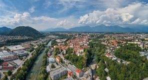Panorama view of Kranj, Slovenia, Europe. Kranj in Slovenia with St. Cantianus Church in the foreground and the Kamnik Alps behind royalty free stock images