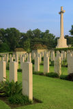 Kranji war memorial. Tombs erected before a large cross which is the key structure for this landmark Stock Photography
