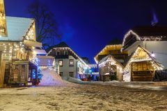 Kranjska Gora Christmas Decorated Square, Alpine village by night. Marketplace and houses covered in snow, no people Royalty Free Stock Photo
