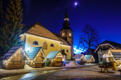 Kranjska Gora Christmas Decorated Square, Alpine village by night. Marketplace and houses covered in snow, no people Royalty Free Stock Images