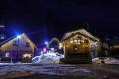 Kranjska Gora Christmas Decorated Square, Alpine village by night. Marketplace and houses covered in snow, no people Stock Photos