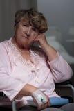 Kranke Frau ohne Hoffnung Stockbild