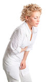 Kranke junge Frau. Magenschmerz. stockfotografie