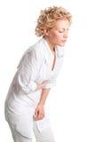 Kranke junge Frau. Magenschmerz. stockfoto