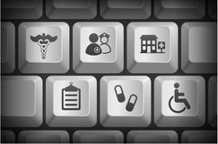 Krankenhaus-Ikonen auf Computer-Tastatur-Knöpfen Stockfoto